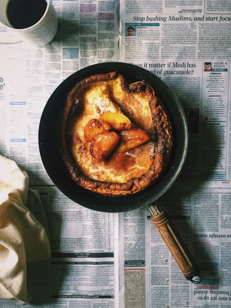 A Dutch Baby Pancake With Caramelised Peaches